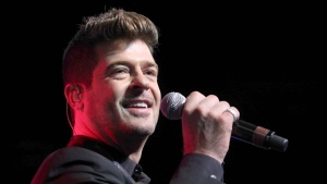 In this Aug. 7, 2015, file photo, Robin Thicke performs during the Steve Harvey Morning Show live broadcast at the Georgia World Congress Center in Atlanta. Thicke's girlfriend, April Love Geary, announced on Instagram Aug. 17, 2017, that she's expecting a baby with the singer. (Photo by Robb D. Cohen/Invision/AP, File)