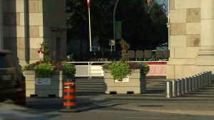Concrete barricades are shown outside the entrance to the CNE on Friday morning.