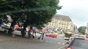 Turku Market Square on Friday, Aug. 18, 2017, with a yellow ambulance on the corner of the square (behind red car). Police in Finland say they have shot a man in the leg after he was suspected of stabbing several people in the western city of Turku. (Lehtikuva via AP)