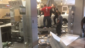 A white pickup truck that crashed into Hillcrest Mall on Friday is shown in this photo submitted by a viewer.