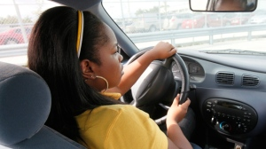 In this Monday, Nov. 23, 2009 photo, Ashley Crawford, 16, drives during her driver's ed class at Miami Killian Senior High School in Miami. (AP Photo/Wilfredo Lee)