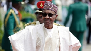 In this Friday, May 29, 2015 file photo, Nigerian President elect, Muhammadu Buhari, arrives for his Inauguration at the eagle square in Abuja, Nigeria. (AP Photo/Sunday Alamba, File)