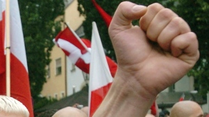 In this file photo dated Saturday, Aug. 21, 2004, Neo-Nazi sympathisers demonstrate prior to the beginning of a commemoration march for Adolf Hitler's deputy Rudolf Hess in the northeastern Bavarian town of Wunsiedel where Hess is buried. (AP Photo/FILE)