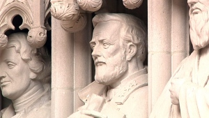 This Jan. 15, 2017, photo, taken from video, shows the undamaged statue of Confederate Gen. Robert E. Lee at the entrance to Duke Chapel in Durham, N.C. The statue was removed Saturday morning after someone hacked at the face earlier in the week. (AP Photo/Allen G. Breed)