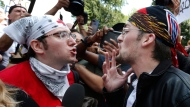 "A counterprotester, left, confronts a professed supporter of President Donald Trump at a ""Free Speech"" rally by conservative activists on Boston Common, Saturday, Aug. 19, 2017, in Boston. Thousands of leftist counterprotesters marched through downtown Boston on Saturday, chanting anti-Nazi slogans and waving signs condemning white nationalism ahead of a rally being staged by conservative activists a week after a Virginia demonstration turned deadly. (AP Photo/Michael Dwyer)"