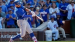 Toronto Blue Jays' Kevin Pillar hits an RBI-single off Chicago Cubs' Hector Rondon during the eighth inning of a baseball game, Saturday, Aug. 19, 2017, in Chicago. Steve Pearce scored on a play. (AP Photo/Kamil Krzaczynski)