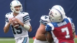 Toronto Argonauts quarterback Ricky Ray (left) looks to make a pass against Montreal Alouettes during the second half of CFL football action in Toronto on Saturday August 19, 2017. THE CANADIAN PRESS/Chris Young