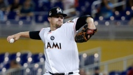 Miami Marlins' Tom Koehler pitches during the first inning of the team's baseball game against the Philadelphia Phillies, Monday, July 17, 2017, in Miami. (AP Photo/Wilfredo Lee)