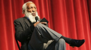 FILE - In this Jan. 20, 2016 file photo, long time civil rights activist, writer, social critic, and comedian Dick Gregory, talks to the crowd at the 16th annual Tampa Bay Black Heritage Festival, MLK Leadership Luncheon, at the University Area Community Development Center, in Tampa, Fla. Gregory, the comedian and activist and who broke racial barriers in the 1960s and used his humor to spread messages of social justice and nutritional health, has died. He was 84. Gregory died late Saturday, Aug. 19, 2017, in Washington, D.C. after being hospitalized for about a week, his son Christian Gregory told The Associated Press. He had suffered a severe bacterial infection. (Scott Keeler /Tampa Bay Times via AP)
