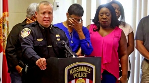 Kissimmee Police Chief Jeff O'Dell, left, holds a news conference Saturday, Aug. 19, 2017 in Kissimmee, Fla. The Kissimmee Police Department says Sgt. Sam Howard died Saturday from his injuries. His colleague, Officer Matthew Baxter, died Friday night after the attack in a neighborhood of Kissimmee, located south of the theme park hub of Orlando. (Red Huber/Orlando Sentinel via AP)