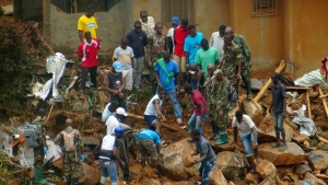 In this Tuesday, Aug.15, 2017 file photo, volunteers search for bodies from the scene of heavy flooding and mudslides in Regent, just outside of Sierra Leone's capital Freetown.  (AP Photo/ Manika Kamara, File)