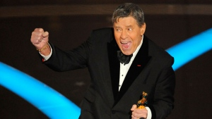 In this Sunday, Feb. 22, 2009, file photo, Jerry Lewis accepts the Jean Hersholt Humanitarian Award by the Board of Governors of the Academy of Motion Picture Arts and Sciences during the Oscars telecast during the 81st Academy Awards, in the Hollywood section of Los Angeles. Lewis, the comedian and director whose fundraising telethons became as famous as his hit movies, has died. Lewis died Sunday, Aug. 20, 2017, according to his publicist. He was 91. (AP Photo/Mark J. Terrill, File)