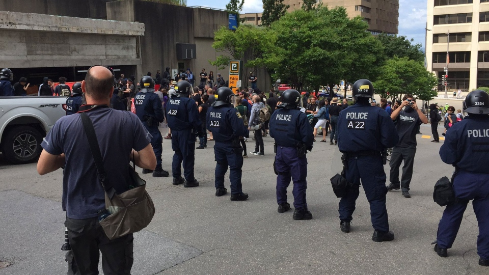 Police square off with protesters in Quebec City Sunday August 20, 2017. (Rob Lurie /CTV)