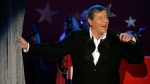 In this Sept. 5, 2005, file photo, longtime host Jerry Lewis performs during the Muscular Dystrophy Association telethon in Beverly Hills, Calif. Lewis, the comedian and director whose fundraising telethons became as famous as his hit movies, has died. Lewis died Sunday, Aug. 20, 2017, according to his publicist. He was 91. (AP Photo/Jae C. Hong, File)