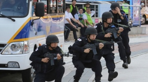 South Korean police officers conduct an anti-terror drill as part of Ulchi Freedom Guardian exercise, in Goyang, South Korea, Monday, Aug. 21, 2017. U.S. and South Korean troops kicked off their annual drills Monday that come after U.S. President Donald Trump and North Korea exchanged warlike rhetoric in the wake of the North's two intercontinental ballistic missile tests last month. (AP Photo/Ahn Young-joon)