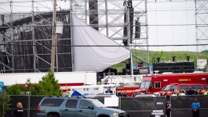 Emergency personnel are on scene near a collapsed stage at Downsview Park in Toronto on Saturday, June 16, 2012. THE CANADIAN PRESS/Nathan Denette