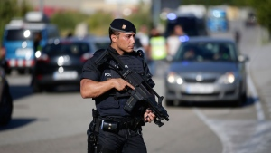 An armed police officer stands guard near Subirats, Spain, Monday, Aug. 21, 2017.  (AP Photo/Manu Fernandez)