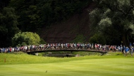 Spectators cross the bridge between the 13th and 14th holes during the Canadian Open golf tournament at Glen Abbey golf club, in Oakville, Ont., on Saturday, July 29, 2017. THE CANADIAN PRESS/Nathan Denette