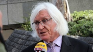 "FILE - In a May 24, 2017 file photo, Tom Mesereau, attorney for model and Playboy bunny Danielle ""Dani"" Mathers, talks to reporters outside Los Angeles County Superior Court. Bill Cosby's spokesman announced Monday, Aug. 21, 2017, that Cosby has hired Mesereau,, Michael Jackson's former lawyer, to represent him at his November retrial on sexual assault charges in Pennsylvania. (AP Photo/Reed Saxon, File)"