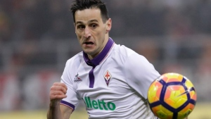 In this Sunday, Feb. 19, 2017 file photo, Fiorentina's Nikola Kalinic keeps his eyes on the ball during a Serie A soccer match at the San Siro stadium in Milan, Italy. Fiorentina forward Nikola Kalinic has missed training Thursday, Aug. 17, 2017 as he attempts to push through a move to AC Milan. Fiorentina says Kalinic did not have permission to skip Thursday's training session and had not given any reason. (AP Photo/Antonio Calanni, Files)