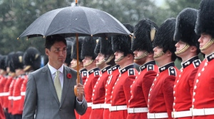 Prime Minister Justin Trudeau inspects the honour guard during a ceremony in honour of the 75th anniversary of the Dieppe Raid, at the National War Memorial in Ottawa on Tuesday, Aug. 22, 2017. THE CANADIAN PRESS/Justin Tang