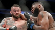 File- This July 8, 2017, file photo shows Daniel Omielanczuk, left, hitting Curtis Blaydes in a heavyweight mixed martial arts bout at UFC 213, in Las Vegas. The UFC is set to use a technology platform that could enhance the way fans watch fights. The world's leading mixed martial arts promotion has reached a partnership with Heed. The joint venture between WME-IMG and AGT International wants to change the way fans connect with sports at home or at a live event through sensor-measured data.(AP Photo/John Locher, File)