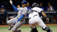 Toronto Blue Jays' Ezequiel Carrera, left, scores around Tampa Bay Rays catcher Wilson Ramos on a sacrifice fly by Norichika Aoki during the fifth inning of a baseball game Tuesday, Aug. 22, 2017, in St. Petersburg, Fla. (AP Photo/Chris O'Meara)