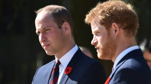This is a Sunday, April 9, 2017, file photo of Britain's Prince William,  left, and Britain's Prince Harry as they arrive at the Canadian National Vimy Memorial in Vimy, near Arras, northern France, to attend the commemorations of the 100th anniversary of the Battle of Vimy Ridge. Princes William and Harry have spoken candidly about the death of their mother, Princess Diana, in an interview marking 20 years since she was killed in a car crash.  (Philippe Huguen/Pool Photo, File via AP)