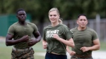 "Model and actress Kate Upton takes part in a ""workout with the Marines"" to raise awareness for Marine Week, Tuesday, Aug. 22, 2017, in Detroit. Upton, fiancé of Detroit Tigers pitcher and Wins for Warriors founder Justin Verlander, and other Tigers Wives participated in a scaled-down workout led by Gunnery Sergeant Sara Pacheco to help support and promote the 2017 Wins for Warriors Patriot Ruck, taking place Saturday, Sept. 9 in Detroit. (AP Photo/Carlos Osorio)"
