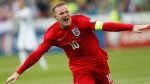 This is a Sunday, June 14, 2015 file photo of England's Wayne Rooney as he  celebrates his goal during the Euro 2016 Group E qualifying soccer match between Slovenia and England, in Ljubljana, Slovenia. England striker Wayne Rooney announced his immediate retirement from international football on Wednesday Aug. 23, 2017.  (AP Photo/Darko Bandic/File)