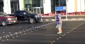 "A 14-year-old boy is seen dancing to the ""Macarena"" at an intersection in the Red Sea city of Jiddah. (Twitter)"