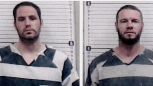 In this combination of photos provided by the Major County, Okla. Sheriff's Office, Andrew Foy, left photo, and Darren Walp, right photo, are pictured in booking photos. Authorities are searching for Foy and Walp, who they say may be armed after overpowering two transport officers and stealing their van in northwestern Oklahoma. (Major County, Okla., Sheriff's Office via AP)