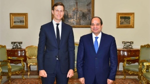 In this photo provided by Egypt's state news agency, MENA, Egypt's President Abdel-Fattah el-Sissi, right, poses for a photo with White House adviser Jared Kushner, in Cairo, Egypt, Wednesday, Aug. 23, 2017. (MENA via AP)