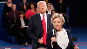 In this Oct. 9, 2016 file photo, Democratic presidential nominee Hillary Clinton, right, speaks as Republican presidential nominee Donald Trump listens during the second presidential debate at Washington University in St. Louis, Sunday, Oct. 9, 2016. (Rick T. Wilking/Pool via AP)