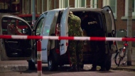 In this image taken from video police officers examine a van behind a cordoned-off area in Rotterdam, Wednesday Aug. 23, 2017. (RTL via AP)