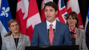 Prime Minister Justin Trudeau, flanked by Laura Albanese, left, Ontario Minister of Citizenship, and Kathleen Weil, Quebec Minister of Immigration, Diversity and Inclusiveness, responds to questions following a meeting of the Intergovernmental Task Force on Irregular Migration Wednesday, August 23, 2017 in Montreal. THE CANADIAN PRESS/Paul Chiasson