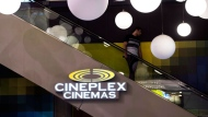 A man makes his way down an escalator during the Cineplex Entertainment company's annual general meeting in Toronto on Wednesday, May 17, 2017. THE CANADIAN PRESS/Nathan Denette