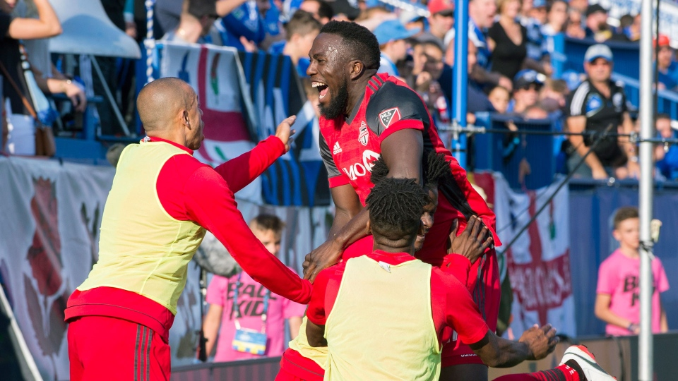Toronto FC's Jozy Altidore celebrates with teammates after scoring against the Montreal Impact during second half MLS soccer action in Montreal, Sunday, August 27, 2017. THE CANADIAN PRESS/Graham Hughes