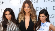 From left, Kim Kardashian, Khloe Kardashian and Kourtney Kardashian attend The Kardashian Family Celebrates the Grand Opening of DASH Miami Beach on Wednesday, March 12, 2014, in Miami Beach, Fla. (Photo by Omar Vega/Invision/AP)
