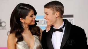 In this Nov. 20, 2011, file photo, Selena Gomez, left, and Justin Bieber arrive at the 39th Annual American Music Awards in Los Angeles. Hackers briefly took control of Gomez's Instagram account on Aug. 28, 2017, and posted nude photos of Bieber. (AP Photo/Chris Pizzello, File)