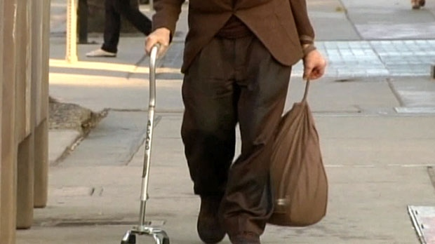 A file photo showing a person walking with a cane is shown.