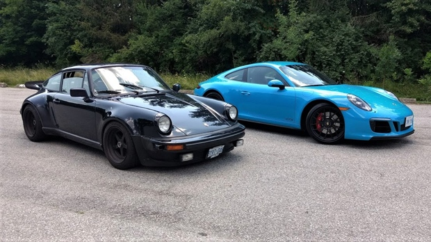 A 1976 Porsche 930 is shown next to a 2018 Porsche 911 Carrera 4 GTS. (Shari Prymak)