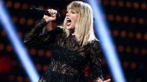 """In this Feb. 4, 2017, file photo, Taylor Swift performs at the DIRECTV NOW Super Saturday Night Concert in Houston, Texas. Billboard announced Tuesday, Sept. 5, 2017, that Swift's new single """"Look What You Made Me Do"""" has topped its Hot 100 chart, unseating """"Despacito"""" from the No. 1 spot after 16 weeks. Swift's song denied the song by Luis Fonsi and Daddy Yankee from breaking a record set by Mariah Carey and Boyz II Men for the longest son atop the Hot 100 chart. (Photo by John Salangsang/Invision/AP, File)"""