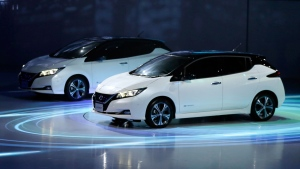 Nissan's new Leaf electric vehicles are showed during the world premiere in Chiba, near Tokyo Wednesday, Sept. 6, 2017. (AP Photo/Eugene Hoshiko)