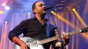 In this June 28, 2013, file photo, Dave Matthews of The Dave Matthews Band performs onstage at the Susquehanna Bank Center in Camden, N.J. The Dave Matthews Band, Justin Timberlake, Pharrell Williams and Ariana Grande will be among the performers at a free unity concert in Charlottesville on Sept. 24, 2017. (Photo by Owen Sweeney/Invision/AP, File)
