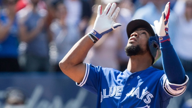 Toronto Blue Jays Teoscar Hernandez gestures as he approaches home plate after hitting a three-run homer off Detroit Tigers pitcher Anibal Sanchez during fifth inning Major League baseball action in Toronto on Sunday, September 10, 2017. THE CANADIAN PRESS/Chris Young