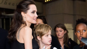 "Director and Actress Angelina Jolie, left, shares a moment with her child Shiloh Jolie-Pitt on the red carpet for the movie ""First They Killed My Father"" during the 2017 Toronto International Film Festival in Toronto on Monday, September 11, 2017. THE CANADIAN PRESS/Nathan Denette"