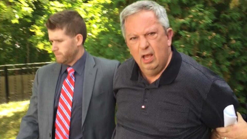 Nick Shcherban is shown being taken into custody on Monday. (Courtesy: Toronto Star)