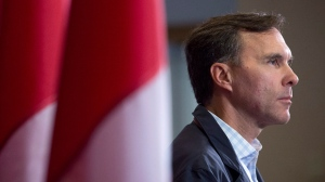 Finance Minister Bill Morneau takes questions as the Liberal cabinet meets in St. John's, N.L. on Tuesday, Sept. 12, 2017. THE CANADIAN PRESS/Andrew Vaughan
