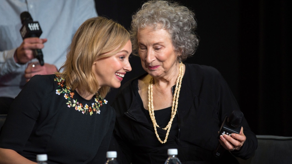 "Author Margaret Atwood whispers to actor Sarah Gadon during a press conference for ""Alias Grace"" at the Toronto International Film Festival on Tuesday, September 12, 2017. THE CANADIAN PRESS/Chris Donovan"